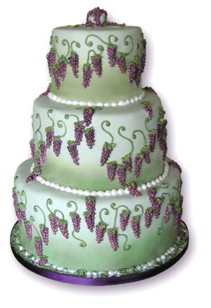 Green and purple wedding cake with grapes
