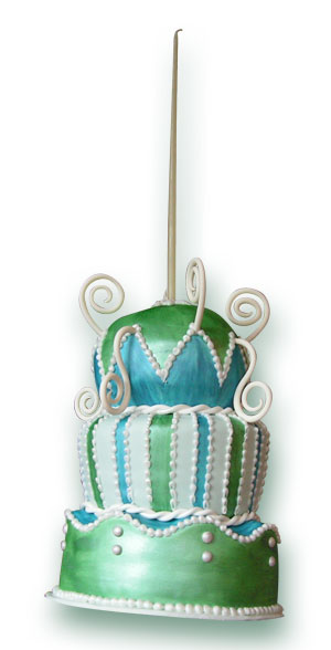 very tall green and blue birthday cake
